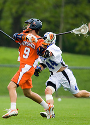 Virginia attackman Danny Glading (9) shoots past Duke defenseman Tony McDevitt (44).  The #2 ranked Duke Blue Devils defeated the #3 ranked Virginia Cavaliers 11-9 in the finals of the Men's 2008 Atlantic Coast Conference tournament at the University of Virginia's Klockner Stadium in Charlottesville, VA on April 27, 2008.