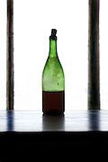 dirty wine bottle with old wine
