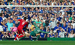 LIVERPOOL, ENGLAND - Saturday, October 1, 2011: Liverpool's Andy Carroll scores the first goal against Everton during the Premiership match at Goodison Park. (Pic by David Rawcliffe/Propaganda)