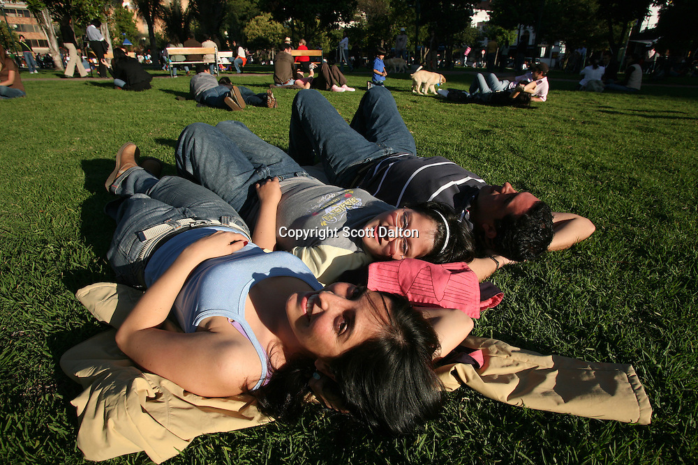 A family enjoys the sunshine in the Parque 93 in north Bogotá on Saturday, May 5, 2007. (Photo/Scott Dalton)
