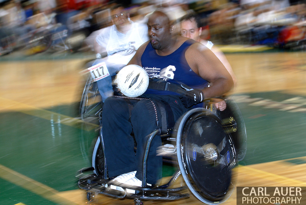 July 7th, 2006: Anchorage, AK - Johnny Holland (6) rolls in for a score as White defeated Blue in the gold medal game of Quad Rugby at the 26th National Veterans Wheelchair Games.