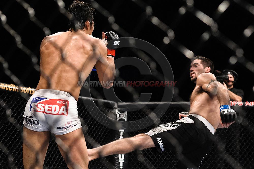 """ATLANTA, GEORGIA, SEPTEMBER 6, 2008: Dong Hyun Kim (left) slips a kick from Matt Brown during """"UFC 88: Breakthrough"""" inside Philips Arena in Atlanta, Georgia on September 6, 2008"""