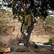 Personal belongings of a Sudan People's Liberation Movement (SPLA-N) rebel fighter, are seen near a tree in Jebel Kwo military base near Tess village in the rebel-held territory of the Nuba Mountains in South Kordofan.