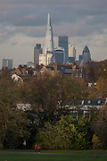 With the capital and the Shard rising high in the background, is housing and the autumn trees in Brockwell Park in Herne Hill, Lambeth SE24 south London.