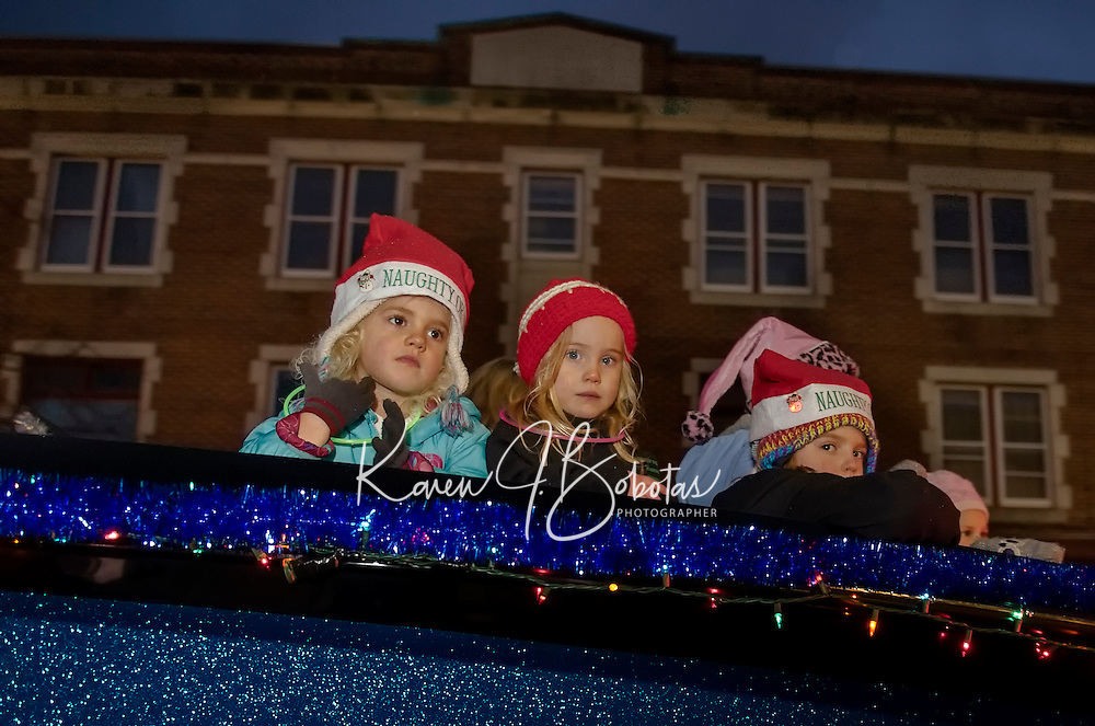 "The Silver Sands Marina float with the ""naughty or nice"" crew make their way down Main Street during the annual Holiday Parade on Saturday evening.  (Karen Bobotas/for the Laconia Daily Sun)"