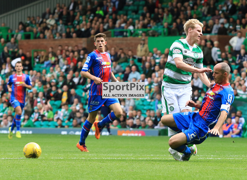 Inverness David  Raven puts a heavy tackle on Celtic's Gary MacKay- Steven during the Glasgow Celtic FC v Inverness Caledonian Thistle FC Scottish Premiership 15th August 2015 ©Edward Linton | SportPix.org.uk