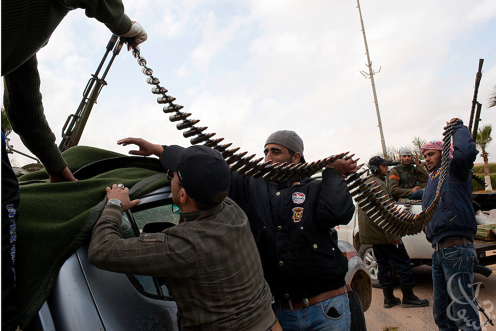 Libyan rebel fighters reload an anti-aircraft gun March 08, 2011 in Ras Lanouf, Libya. For more than 2 weeks rebels in Eastern Libya have been battling pro-Qadaffi forces, seeking to topple the nearly 42 year old dictatorship of Col Moammar el-Qadaffi.