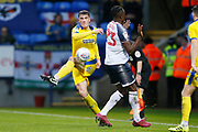 Ryan Delaney of Wimbledon clears the ball during the EFL Sky Bet League 1 match between Bolton Wanderers and AFC Wimbledon at the University of  Bolton Stadium, Bolton, England on 7 December 2019.
