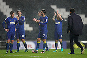 AFC Wimbledon midfielder Dannie Bulman (4), AFC Wimbledon midfielder Chris Whelpdale (11), AFC Wimbledon defender George Francomb (7) and AFC Wimbledon defender Barry Fuller (2) applaud the fans at the final whistle of the EFL Sky Bet League 1 match between Milton Keynes Dons and AFC Wimbledon at stadium:mk, Milton Keynes, England on 10 December 2016.