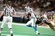 Wide Receiver Az-Zahir Hakim (81) of the St. Louis Rams tries to tackle Defensive back Deon Grant (27) of the Carolina Panthers after and interception during a 48 to 14 win by the Rams on 11/11/2001.©Wesley Hitt/NFL Photos