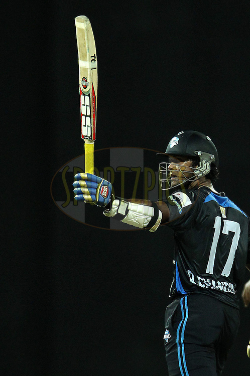 Dinesh Chandimal celebrates his fifty, half century during match 20 of the Sri Lankan Premier League between Ruhuna Royals and Wayamba United held at the Premadasa Stadium in Colombo, Sri Lanka on the 26th August 2012. .Photo by Ron Gaunt/SPORTZPICS/SLPL