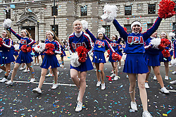 © London News Pictures. 01/01/2012. London, UK. All American Cheerleaders from USA present a routine to the songs of Lady Gaga  at the 2012 New Years Parade in London on January 1st, 2012. Photo credit : Ben Cawthra/LNP