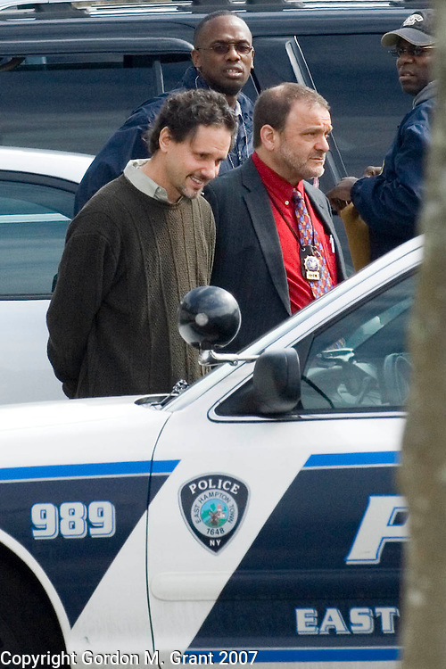 Amagansett, NY - 3/13/07 -   Dr. Michael Chait, left, is escorted out of his office in Amagansett, NY March 13, 2007. The raid on his office came after a 7 month investigation by the State Attorneys General Office. County, State and East Hampton Town Police, as well as the DEA participated in the raid that took place Tuesday morning.    (Photo by Gordon M. Grant)