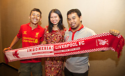 JAKARTA, INDONESIA - Tuesday, July 16, 2013: Liverpool supporter Adjeng Pradha from Jakarta, wearing a Liverpool FC insider dress designed by her friend, pictured with fellow supporters Ivan Marky [l] and Tommy Perwira [r] ahead of the Reds' visit to Indonesia as part of their Preseason Tour. (Pic by David Rawcliffe/Propaganda)