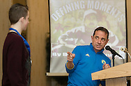 Boston Marathon race director Dave  McGillivray speaks at a special meeting of the  Orange Runners Club at Kuhl's Highland House in MIddletown, New York  on March 4, 2015. McGillivray was pointing at John Parsells of Pine Bush, at left. McGillivray gave Parsells a marathon finsher's medal - but Parsells has to mail that medal back after completing his first marathon.