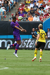 July 22, 2018 - Charlotte, NC, U.S. - CHARLOTTE, NC - JULY 22: Virgil van Dijk (4) of Liverpool heads the ball during the International Champions Cup soccer match between Liverpool FC and Borussia Dortmund in Charlotte, N.C. on July 22, 2018. (Photo by John Byrum/Icon Sportswire) (Credit Image: © John Byrum/Icon SMI via ZUMA Press)