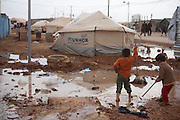 Syrian refugee children play in flooded surroundings  at the Za'atri Syrian refugee camp in northern Jordan February 6,2013. ..Jordan  recently announced  that the number of Syrian refugees in the country is expected to exceed 700, 000 in 2013, the state-run Petra news agency reported. (Photo by Heidi Levine/Sipa Press).