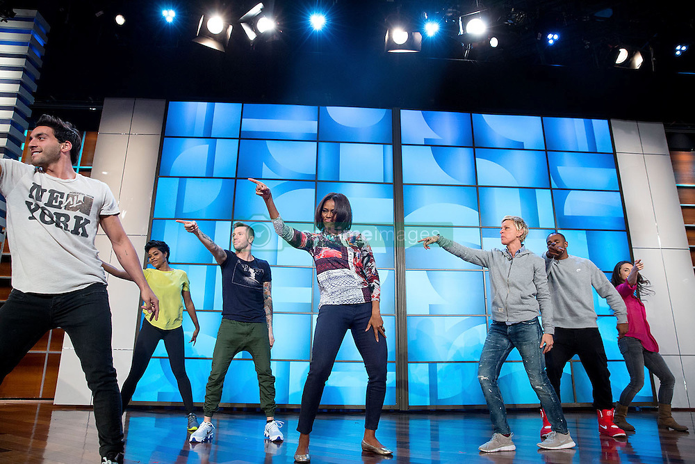 First Lady Michelle Obama rehearses with Ellen DeGeneres and the &quot;So You Think You Can Dance&quot; dancers for a #GimmeFive &quot;Let's Move!&quot; dance, prior to a taping of The Ellen DeGeneres Show in Burbank, Calif., March 12, 2015. (Official White House Photo by Amanda Lucidon)<br /> <br /> This official White House photograph is being made available only for publication by news organizations and/or for personal use printing by the subject(s) of the photograph. The photograph may not be manipulated in any way and may not be used in commercial or political materials, advertisements, emails, products, promotions that in any way suggests approval or endorsement of the President, the First Family, or the White House.