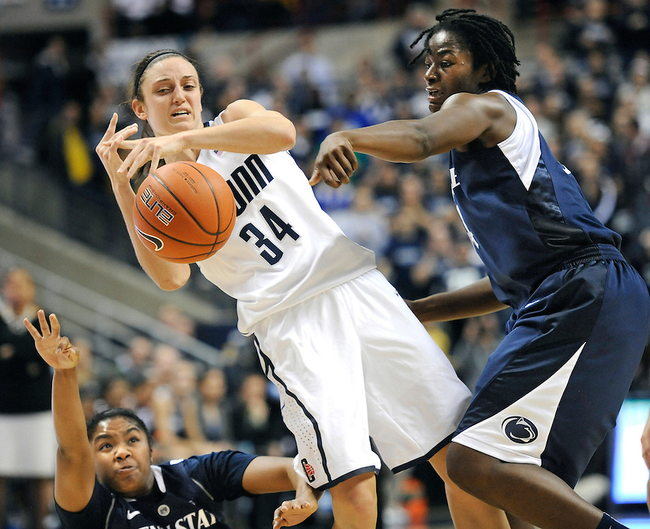 Connecticut's Kelly Faris, center, is pressured by Penn State's Alex Bentley, left, and Penn State's Nikki Greene, right, during the first half of an NCAA college basketball game in Storrs, Conn., Thursday, Dec. 6, 2012. (AP Photo/Jessica Hill)