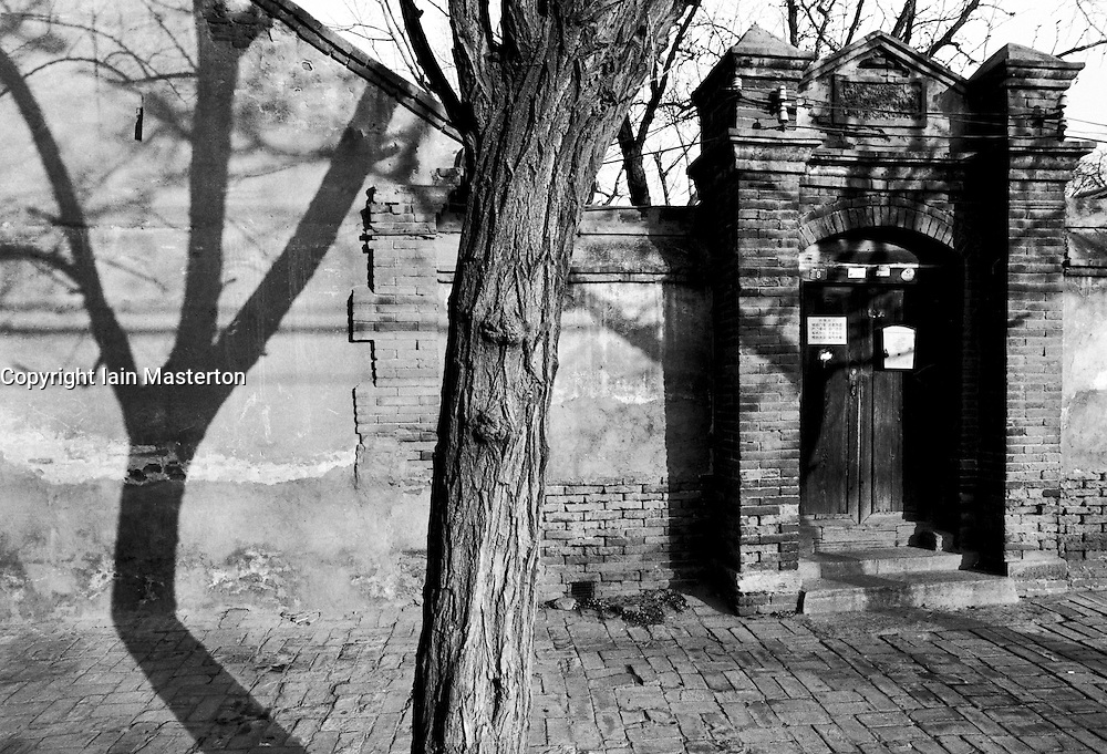 Exterior walls and doorway to a traditional old courtyard house in a Beijing hutong