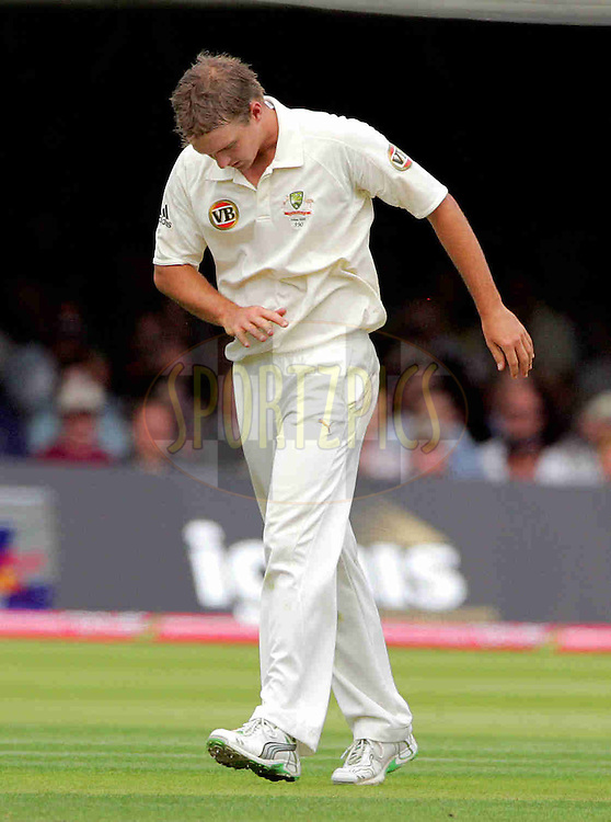 © Andrew Fosker / Seconds Left Images 2009  -  Nathan Hauritz looks at his  damaged middle finger after trying to take a catch off his own bowling - England v Australia - The Ashes 2009 - Second npower Test  Match - Day 1 - 16/07/09 - Lord's Cricket Ground - St.  John's Wood - London - UK - All Rights Reserved