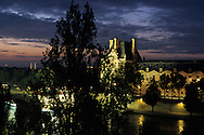 France. Paris. 6th district. Elevated view. The louvre museum and the seine river quays . view from the hotel du quai Voltaire  at sunset and night