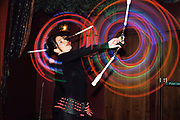 A women dancing with glowing poi at Funktup, December 2004