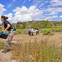 A body is carried away by staff of Rollie Mortuary after being found in a ditch next to the train track in Gallup.