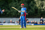 Afghan player Rahmat Shah salutes his team mates after he scores 50 runs during the One Day International match between Scotland and Afghanistan at The Grange Cricket Club, Edinburgh, Scotland on 10 May 2019.