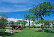 Sculpture of Ox with Red River Cart in Assiniboine Park<br /> Winnipeg<br /> Manitoba<br /> Canada