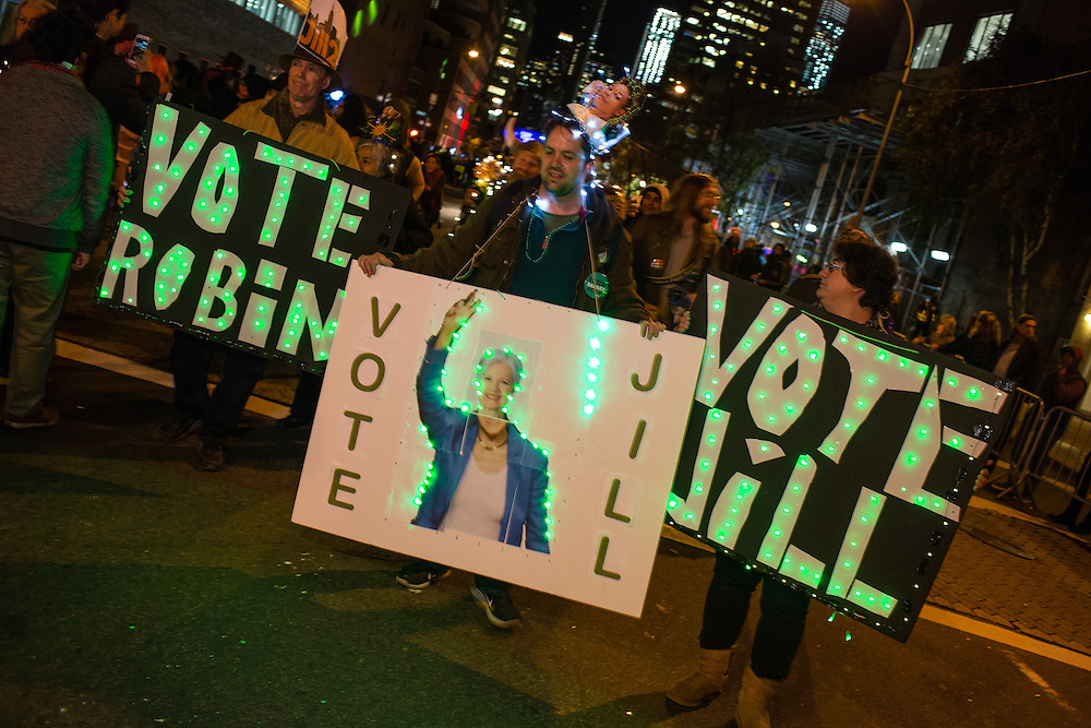 New York, NY - 31 October 2016. Marchers in the annual Greenwich Vilage Halloween Parade carry signs in support of Green Party presidential candidate Jill Stein.