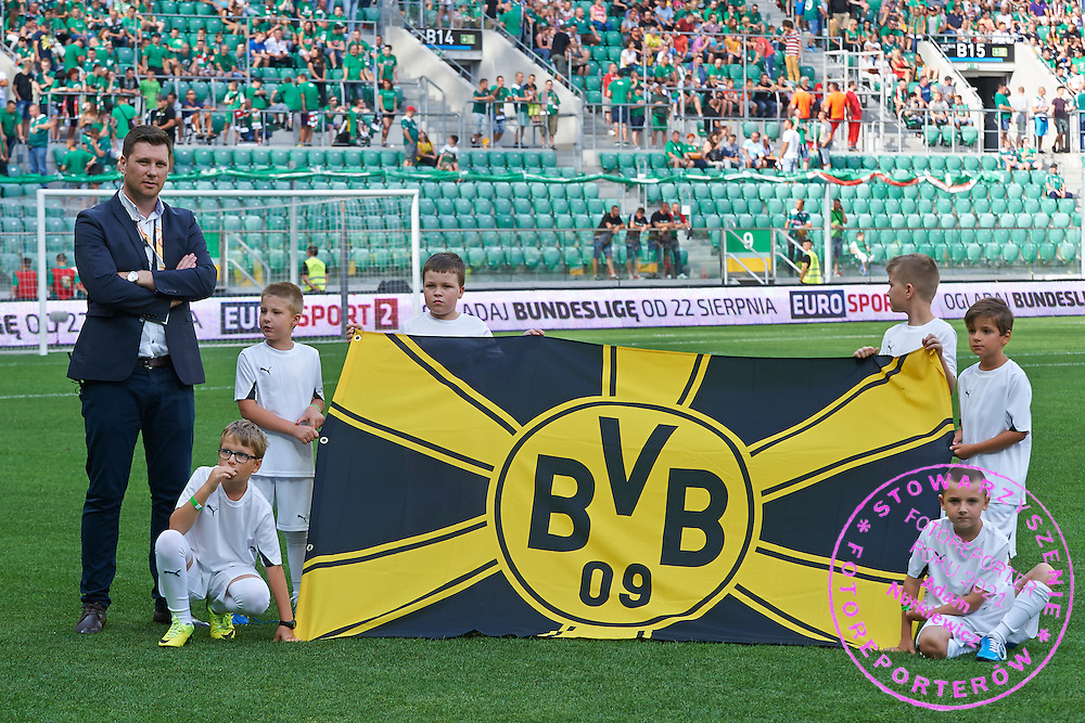 Children with flag on the pitch before international friendly soccer match between WKS Slask Wroclaw and BVB Borussia Dortmund on Municipal Stadium in Wroclaw, Poland.<br /> <br /> Poland, Wroclaw, August 6, 2014<br /> <br /> Picture also available in RAW (NEF) or TIFF format on special request.<br /> <br /> For editorial use only. Any commercial or promotional use requires permission.<br /> <br /> Mandatory credit:<br /> Photo by &copy; Adam Nurkiewicz / Mediasport