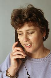 Portrait of woman talking on telephone,