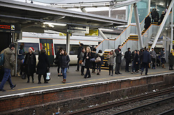 © Licensed to London News Pictures. 19/12/2016. London, UK. Passengers are seen at Clapham Junction. ASLEF Southern Rail drivers have started a two day strike in a dispute over driver-only operated trains. Photo credit: Peter Macdiarmid/LNP