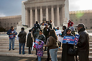 Supporters of the 1964 Voting Rights Act gather on the steps of the U.S. Supreme Court as the Court prepares to hear the case of Shelby County v. Holder, which calls into question one of the law's key provisions.