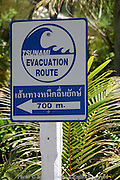 A sign advises people as to the location of the tsunami evacuation route in Ao Nang, Thailand..