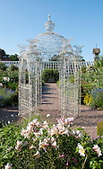 A wire gazebo and Lilium regale at Arley Hall, Northwich, Chesire, UK