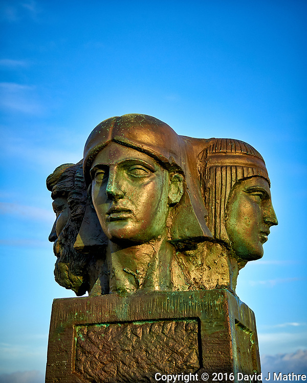 Bronze four-headed statue in the early morning sun on the aft deck of the MV World Odyssey. Semester at Sea, 2016 Spring Semester Voyage. Day 3 of 102. Image taken with a Leica T camera and 23 mm f/2 lens (ISO 100, 23 mm, f/3.5, 1/250 sec).