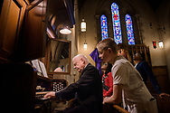 The Rev. Charles McClean performs on the organ for young members of his confirmation class at Our Savior Lutheran Church on Saturday March 24, 2018, in Baltimore. LCMS Communications/Erik M. Lunsford