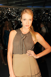 FLORRIE ARNOLD at a party to celebrate the launch of Bang a new male fragrance by Marc Jacobs held at the Fith Floor Restaurant, Harvey Nichols, Knightsbridge, London on 22nd July 2010.