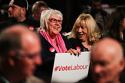 © Licensed to London News Pictures. 09/05/2017. Manchester, UK. Audience members watch on as Labour leader Jeremy Corbyn speaks at a rally in Manchester to launch their general election election campaign. Photo credit : Ian Hinchliffe/LNP