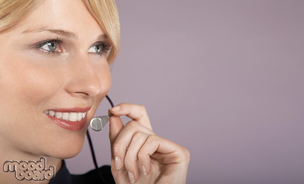 Businesswoman wearing headset close-up portrait