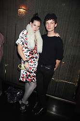 TIM CLIFTON-GREEN and ROSIE VOGEL at a party hosted by Mulberry at Punk, 14 Soho Square, London on 14th October 2008.