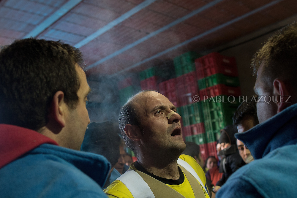 Raul Beites takes breath after he finished his walk representing Jarramplas and beating his drum during the Jarramplas Festival on January 20, 2015 in Piornal, Spain. The centuries old Jarramplas festival takes place annually every January 19-20 on Saint Sebastian Day. Even though the exact origins of the festival are not known, various theories exist including the mythological punishment of Caco by Hercules, a relation to ceremonies celebrated by the American Indians that were seen by the first conquerors, to a cattle thief ridiculed and expelled by his village neighbours. It is generally believed to symbolize the expulsion of everything bad. This year the people who represented Jarramplas were Angel Cerro Fernandez on 19 January and Carlos Calle Rodríguez 47 and Raúl Beites Sánchez 34 on 20 January.