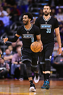 Jan 30, 2017; Phoenix, AZ, USA; Memphis Grizzlies guard Mike Conley (11) dribbles the ball up the court with center Marc Gasol (33) in the first half of the NBA game against the Phoenix Suns at Talking Stick Resort Arena. Mandatory Credit: Jennifer Stewart-USA TODAY Sports