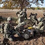 Soldiers of 3 SCOTS (The Black Watch) and 1 PWRR prepare a fellow soldier for an inbound MEDEVAC helicopter.  Private Stephen Bainbridge, aged 25, from Kirkcaldy who was gravely wounded after an IED explosion traumatically amputated his right leg and damaged his left so badly that it too later had to be amputated. His life was saved by the swift actions of Cpl John Goodie (21) a medic with 1 PWRR (The Princess of Wales's Royal Regiment) who applied tourniquets and first field dressings to get the bleeding under control. Private Chis Watson (21) also assisted in the treatment whilst reassuring the casualty and keeping him alert and responsive. Once safely on board the helicopter he was rushed to surgery at Bastion Field Hospital.  Loya Manda, Nad e Ali, Helmand Province, Afghanistan on the 11th of November 2011.
