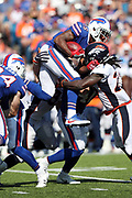 Buffalo Bills wide receiver Brandon Tate (15) tries to leap over a pile of defenders as he returns a third quarter kick 23 yards to the Bills 31 yard line during the 2017 NFL week 3 regular season football game against the against the Denver Broncos, Sunday, Sept. 24, 2017 in Orchard Park, N.Y. The Bills won the game 26-16. (©Paul Anthony Spinelli)