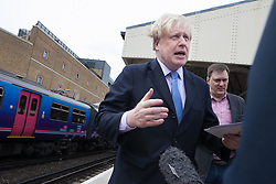 The Mayor of London Boris Johnson giving an interview inside Wimbledon station after meet with residents and launches a public consultation on proposed routes for Crossrail 2 rail project, Wimbledon, London, UK, 14th May, 2013. Photo by: Daniel Leal-Olivas / i-Images
