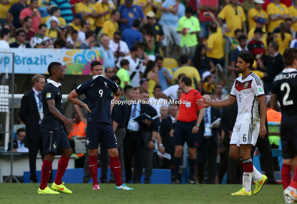 Fifa Soccer World Cup - Brazil 2014 - <br /> FRANCE (FRA) Vs. GERMANY (GER) - Quarter-finals - Estadio do Maracana Rio De Janeiro -- Brazil (BRA) - 04 July 2014 <br /> Here French player Olivier GIROUD (L). German player Sami KHEDIRA (R).   End of the match. Germany win the match 1-0.<br /> &copy; PikoPress