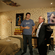 """Mayor Richard Daley,right, gets a tour of Groupon's headquarters by founder and CEO Andrew Mason Tuesday August 31, 2010. Mason, left, shows their """"crazy room"""" at Groupon's headquarters are in the former Montgomery Wards' catalog warehouse.  Jose More Photography..."""